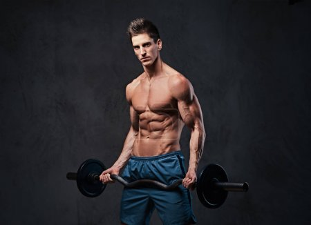 Athletic shirtless male biceps barbell workout over grey background.