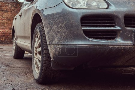 Close-up image of a dirty car after a trip off-road. Side mirror. Front view.