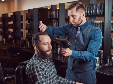 Professional barber working with a