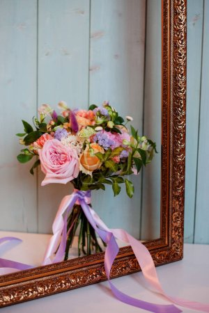 beautiful lush bouquet with roses, turquoise background, gift