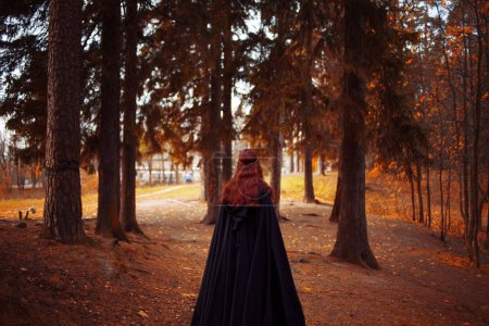 Young beautiful and mysterious woman in the woods,...