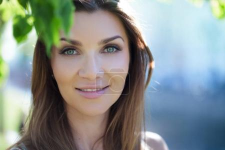 Photo for Close-up portrait of a beautiful woman, brunette. On background summer nature - Royalty Free Image