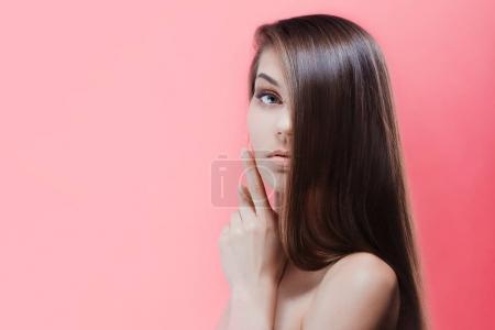 Photo for Beauty portrait of brunette with perfect hair, on a pink background - Royalty Free Image