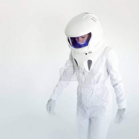 Fantastic space suit walk alone in empty. Astronaut on white background