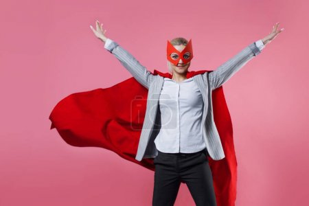 Young attractive woman superhero. Girl in a busine...