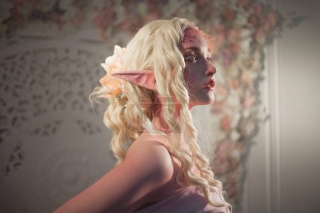 Attractive elf portrait on light background. Fantasy and fairy tale, computer games.