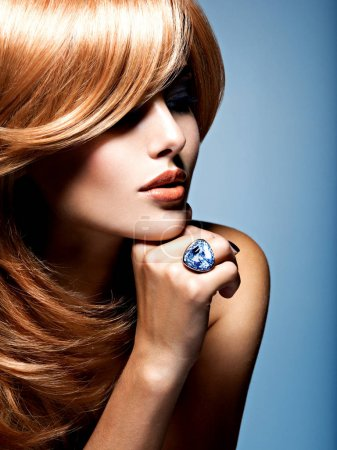 woman with sapphire jewelry ring