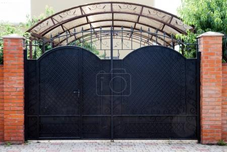 Photo for Beautiful metal gates at the cottage, summer day. - Royalty Free Image
