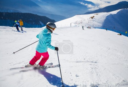 woman skiing on a snowy road