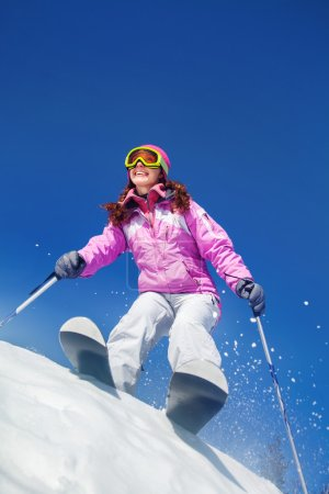 Young woman skiing in the mountains