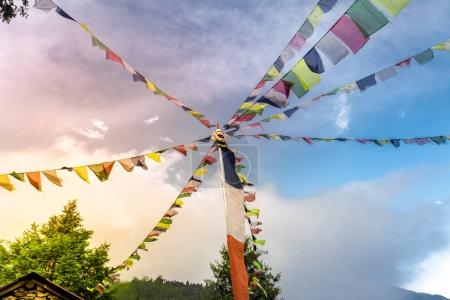Buddhist tibetan prayer flags against blue sky