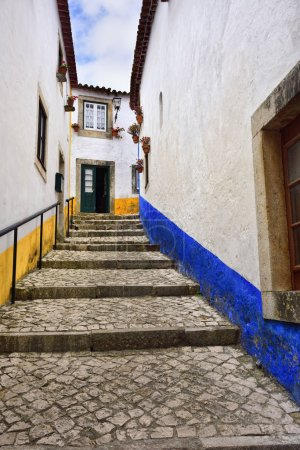 In the streets of the picturesque town of Obidos, Portugal