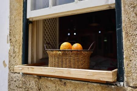Oranges in basket, Obidos, Portugal