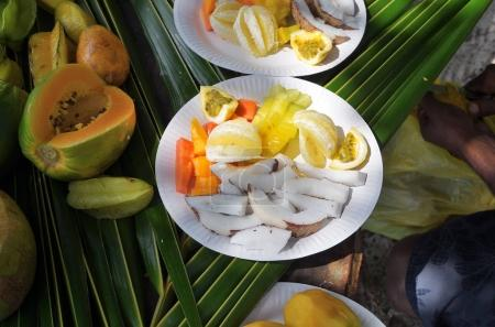 Fruit plates on the palm leaves