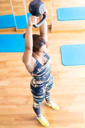 Photo for Yong woman in gym doing excercises session - Royalty Free Image