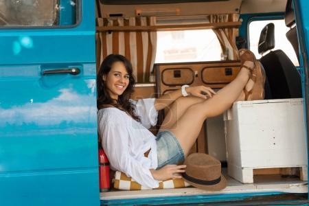 Pretty woman enjoing a trip by minivan car
