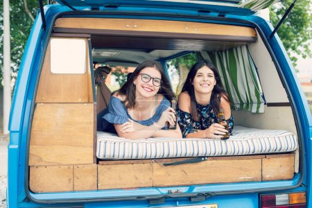 Young women travelling by minivan