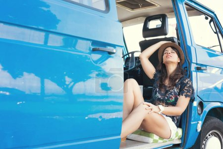 Photo for Pretty woman enjoing a trip by minivan car. Summer holidays, road trip, travel and people concept, young woman resting in minivan car - Royalty Free Image