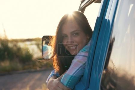 Photo for Happy young pretty woman on vacation, travelling by minivan - Royalty Free Image
