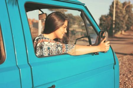 Young woman enjoy travelling by car