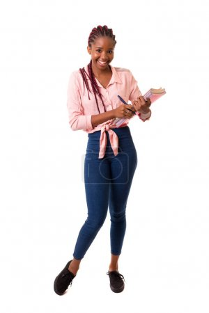 Beautiful African female student standing with books isolated over white background