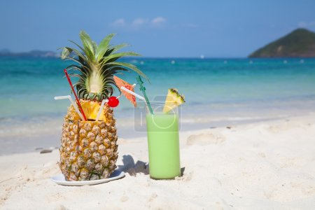 Pineapple cocktail on beach