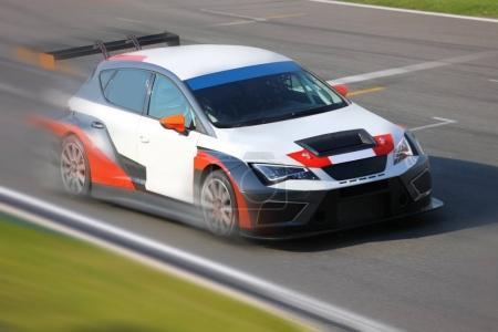 Photo for Race car racing at high speed on speed track - Royalty Free Image