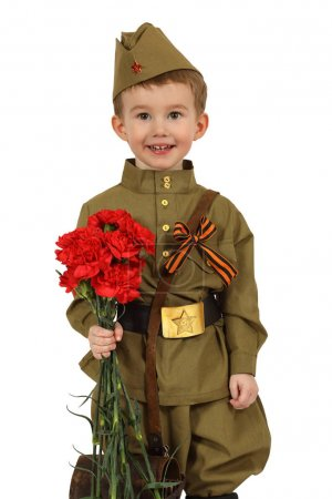 The little boy with a bouquet of red carnations