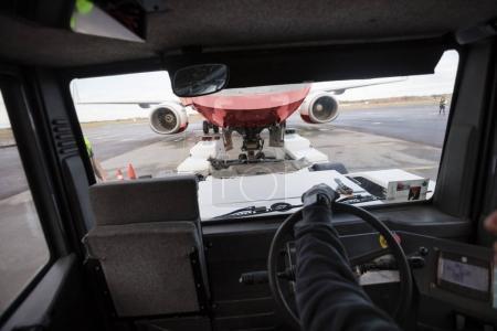 Airplane Seen Through Tow Truck