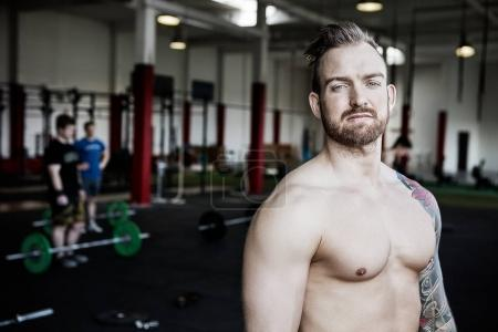 Muscular Proud Man Standing In Fitness Club