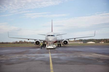 Airplane Being Towed On Runway