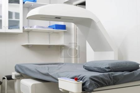 X-Ray Machine Over Bed At Hospital