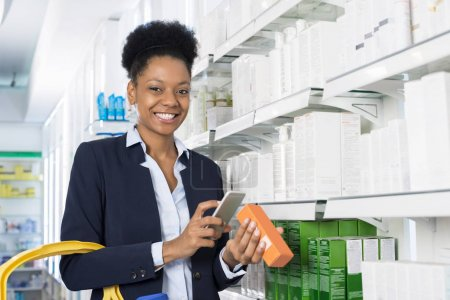 Happy Businesswoman Scanning Barcode Through Smart Phone