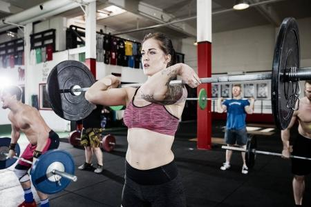 Beautiful Woman Lifting Barbell
