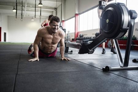Determined Man Practicing Pushups In Gym