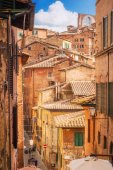 5.05.2017 - A view of a typical narrow street and generic architecture in Siena, Tuscany, Italy