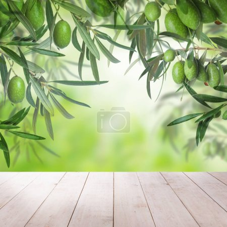 White empty wooden table, green olives fruit and leaves