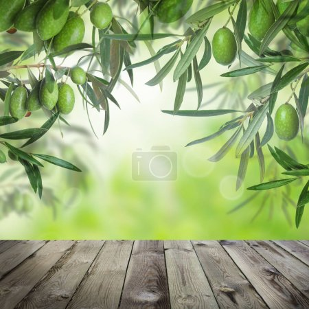 Olives with Green Leaves, Summer Bokeh Light and Wooden Table