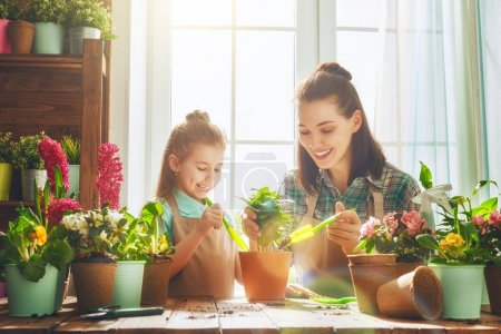 Mom and daughter engaged in gardening