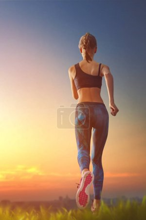 Girl is jogging on sunset