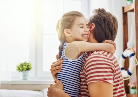 Photo for Happy father's day! Dad and his daughter child girl are playing, smiling and hugging. Family holiday and togetherness. - Royalty Free Image