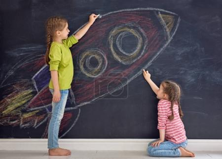 children are drawing rocket