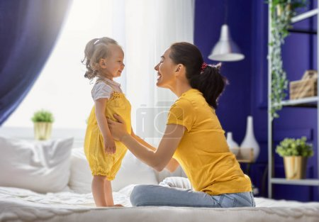Mom and her daughter are playing