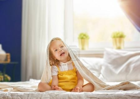 baby girl on the bed