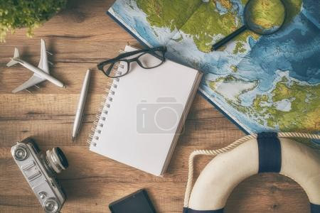 Photo for Go on an adventure! The map and the camera on a wooden table. Top view. - Royalty Free Image