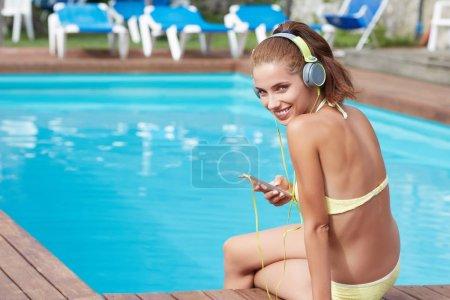 Sexy woman in the yellow bikini