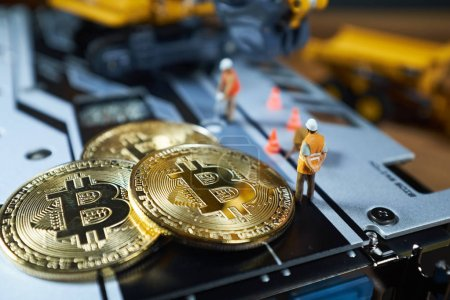 A little miner is digging on graphic card with golden coin. bitcoin mining and crypto currency concept.