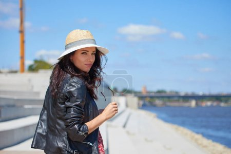 Photo for Portrait of happy smiling woman standing on the square on sunny summer or spring day outside, cute smiling woman looking at you, - Royalty Free Image