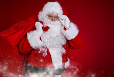 Photo for Santa Claus with a bag of gifts - Royalty Free Image