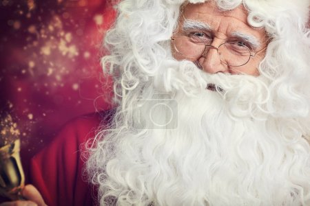 Photo for Traditional Santa Claus ringing on a bell, concept coming Christmas - Royalty Free Image
